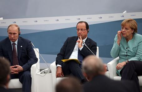 Президент РФ Владимир Путин, президент Франции Франсуа Олланд и канцлер Германии Ангела Меркель (слева направо).