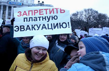 На митинге автомобилистов против политики московского департамента транспорта на Суворовской площади, 7 декабря 2014 года.