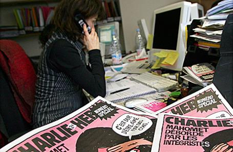 В редакции журнала «Шарли Эбдо» в Париже.