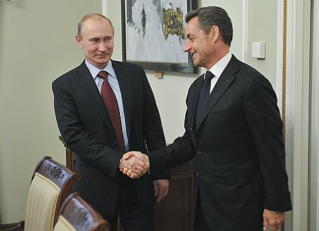 Президент России Владимир Путин и экс-президент Франции Николя Саркози.