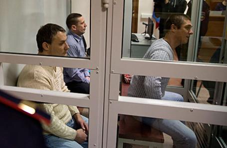 Обвиняемые в убийстве Михаила Кравченко Михаил Ищенко, Виталий Антишин и Алексей Пронин (слева направо).