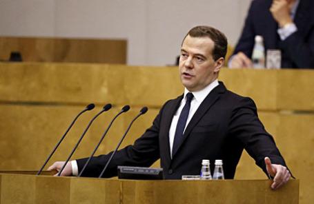 Премьер-министр РФ Дмитрий Медведев во время выступления с отчетом о результатах деятельности правительства РФ за 2014 год на пленарном заседании Госдумы РФ.