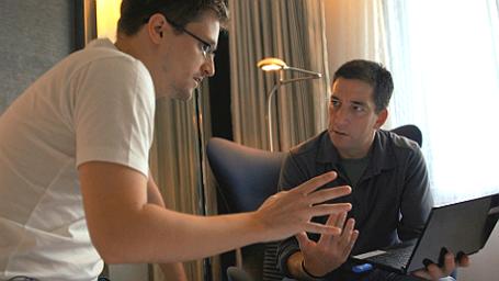 Эдвард Сноуден и Гленн Гринвальд в фильме «Citizenfour: Правда Сноудена».