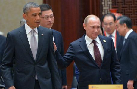 Президент США Барак Обама и президент России Владимир Путин (слева направо).