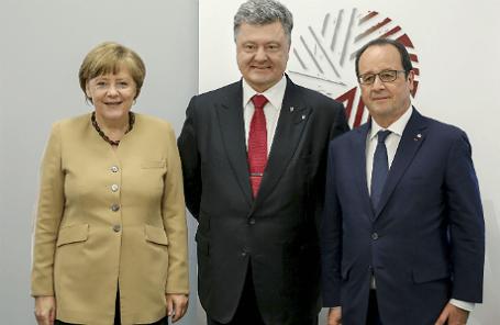 Канцлер Германии Ангела Меркель, президент Украины Петр Порошенко и президент Франции Франсуа Олланд (слева направо)