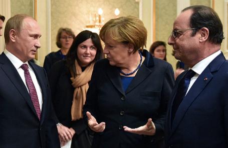 Президент России Владимир Путин, канцлер Германии Ангела Меркель и президент Франции Франсуа Олланд (слева направо).