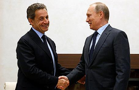 Экс-президент Франции Николя Саркози и президент России Владимир Путин во время встречи в резиденции Ново-Огарево, 29 октября 2015.