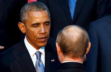 Президент России Владимир Путин (справа на первом плане), президент США Барак Обама.