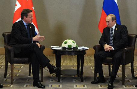 Премьер-министр Великобритании Дэвид Кэмерон и президент России Владимир Путин (слева направо).