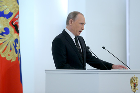Президент России Владимир Путин во время выступления с ежегодным посланием  Федеральному собранию РФ в Кремле, 3 декабря 2015.