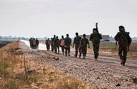 Курдские военнослужащие.