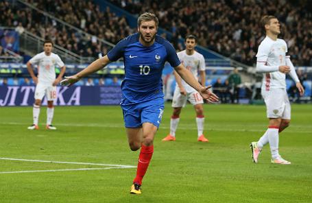 Игрок сборной Франции Андре-Пьер Жиньяк после гола в ворота сборной России в товарищеском матче по футболу между национальными сборными командами Франции и России.