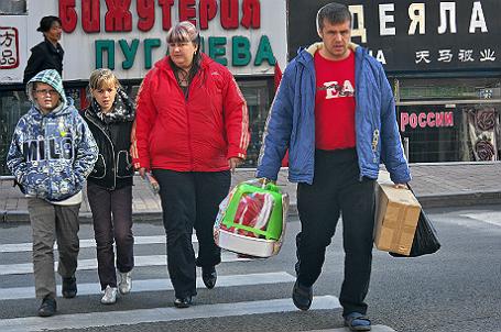 Российские туристы в городе Суйфэньхэ, Китай.