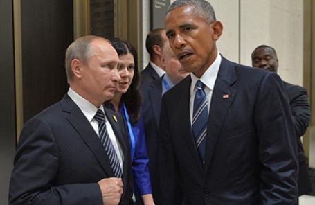 Президент РФ Владимир Путин и президент США Барак Обама (слева направо) во время встречи в Ханчжоу, Китай.