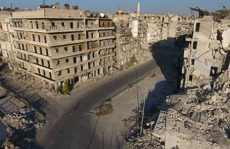 Поврежденные здания в Алеппо.