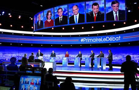 Французские политики принимают участие в теледебатах перед выборами.