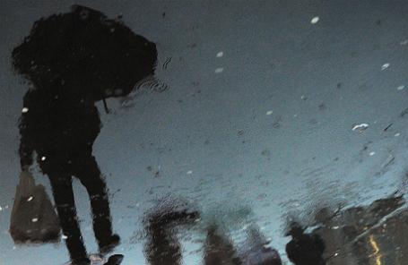 Во время снега с дождем на улицах столицы.