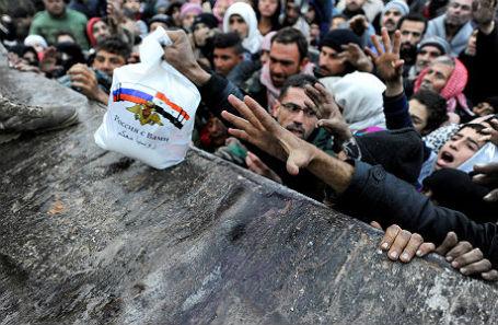 Эвакуированные жители восточного Алеппо.