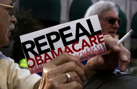 Надпись на листовке: «Отмените Obamacare».