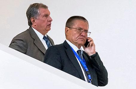 Игорь Сечин (слева) и Алексей Улюкаев.