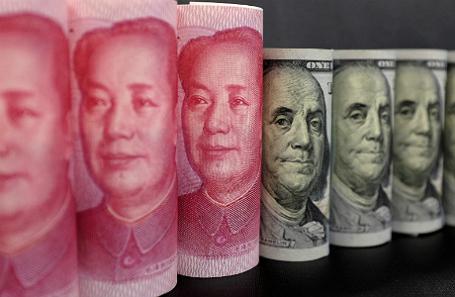 Юани и доллары.