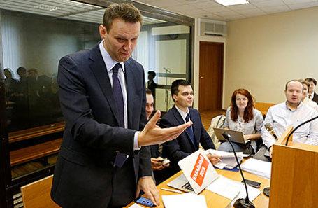 Лидер оппозиции Алексей Навальный на слушании по иску о клевете, поданном против него российским бизнесменом Алишером Усмановым.