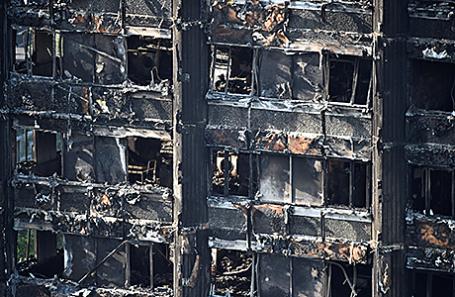 Жилой дом после пожара в Лондоне 14 июня 2017.