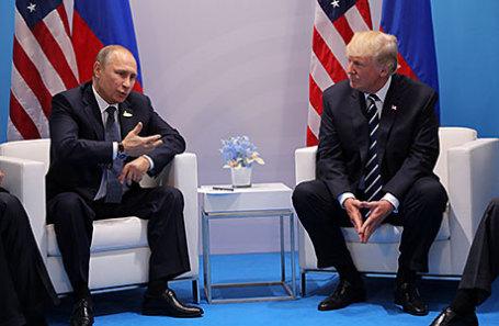 Президент России Владимир Путин и президент США Дональд Трамп (слева направо).