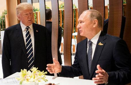 Президент США Дональд Трамп и президент России Владимир Путин на саммите G20 в Гамбурге.