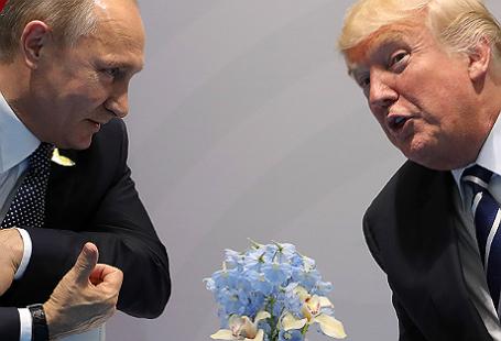 Президент РФ Владимир Путин и президент США Дональд Трамп (слева направо) во время двусторонней встречи на саммите G20 в Гамбурге.