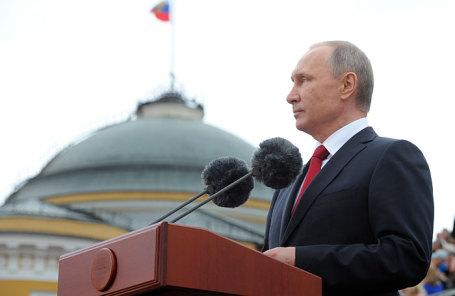 Президент России Владимир Путин выступает на открытии Дня города на Красной площади.