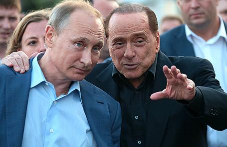 Президент РФ Владимир Путин и бывший премьер-министр Италии Сильвио Берлускони (слева направо).