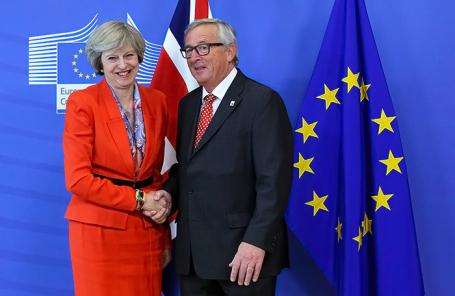 Премьер-министр Британии Тереза Мэй и глава Еврокомиссии Жан-Клод Юнкер.