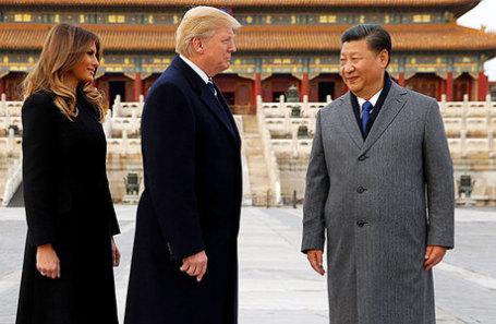 Президент США Дональд Трамп и его супруга Мелания посетили Запретный город с президентом Китая Си Цзиньпин в Пекине.