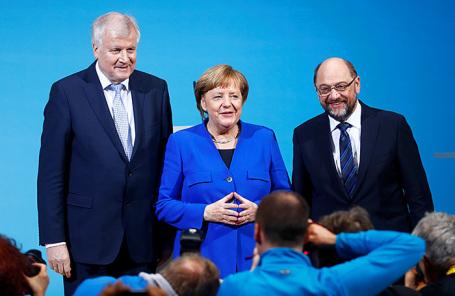 Исполняющий обязанности канцлера Германии Ангела Меркель, лидер Христианского социального союза в Баварии (ХСС) Хорст Зеехофер и лидер Социал-демократической партии (СПД) Мартин Шульц.