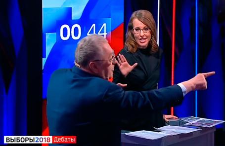 Ксения Собчак и Владимир Жириновский на дебатах.