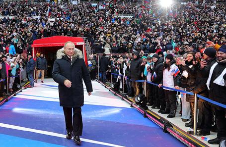 Президент России Владимир Путин во время митинга «За сильную Россию!» на стадионе «Лужники», 3 марта 2018.