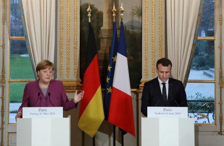 Ангела Меркель и Эммануэль Макрон на пресс-конференции в Елисейском дворце.