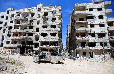 Разрушенные здания в городе Дума близ Дамаска.