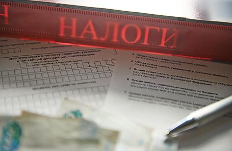 https://cdn.bfm.ru/news/maindocumentphoto/2018/05/16/nalog.jpg