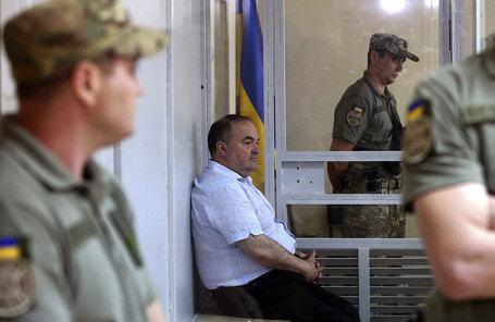 Директор украинско-немецкого предприятия по изготовлению оружия «Шмайсер» Борис Герман, обвиняемый в покушении на российского журналиста Аркадия Бабченко, во время заседания Шевченковского суда по избранию ему меры пресечения.