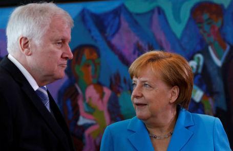 Министр внутренних дел Германии Хорст Зеехофер и федеральный канцлер Германии Ангела Меркель.