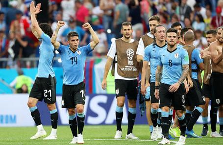 Игроки сборной Уругвая радуются победе в матче группового этапа чемпионата мира по футболу - 2018 между сборными командами Уругвая и Саудовской Аравии.