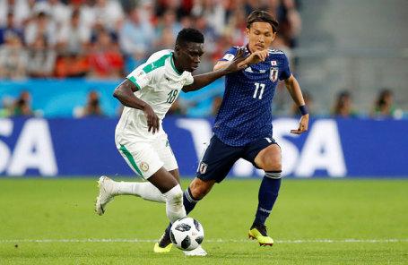 Игроки сборной  Японии и Сенегала в матче группового этапа чемпионата мира по футболу - 2018 между сборными командами Японии и Сенегала.