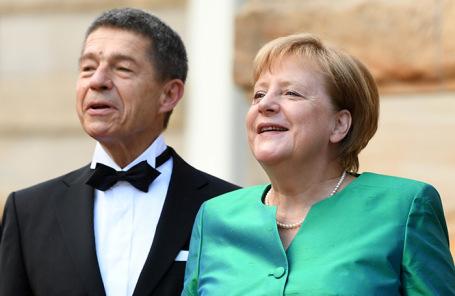 Иоахим Зауэр и Ангела Меркель.