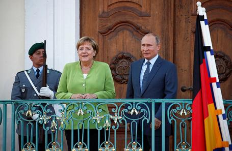 Владимир Путин и Ангела Меркель во время встречи в Гранзе, Германия.