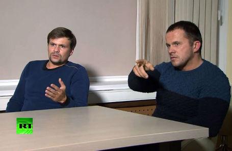 Руслан Боширов и Александр Петров во время интервью главному редактору телеканала RT Маргарите Симоньян.