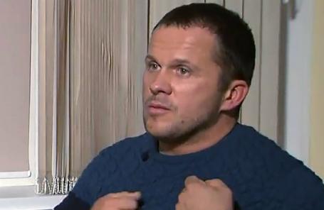 Человек, известный как Александр Петров, во время интервью телеканалу RT.