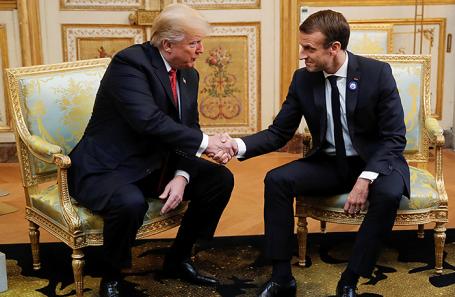 Эммануэль Макрон и Дональд Трамп во время встречи в Париже.
