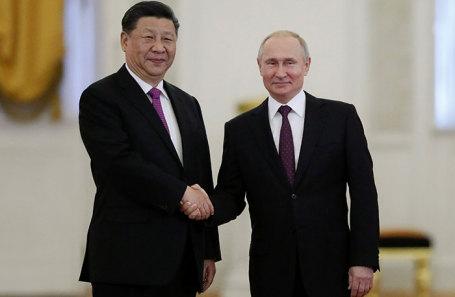 Си Цзиньпин и Владимир Путин во время встречи в Кремле